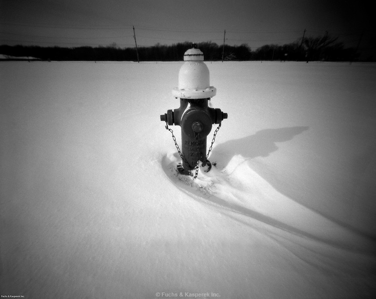 A fire hydrant in a field creates a pattern in the snow in Cahoon Park, Bay Village, OH