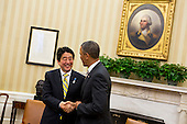 United States President Barack Obama, right, shakes hands with Prime Minister Shinzo Abe of Japan, left, during a photo-op in the Oval Office of the White House in Washington, D.C. following a bilateral meeting between the two leaders on Friday, February 22, 2013. .Credit: Kristoffer Tripplaar  / Pool via CNP