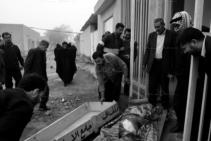 Baghdad, Iraq, March 26, 2003.Al Kindi hospital, next of kins reclaim the corpse of Sarmed Draoudi, 26, killed by one of  two US bombs which fell without apparent reason in Cha'ab avenue, a busy street on the edge of Saddam City, one of the poorest neighbourhood in Baghdad.