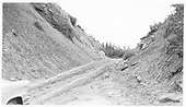 Cut on abandoned RGS line east of Hook at about MP 134.5, looking east.<br /> RGS  Hook, CO  Taken by Maxwell, John W. - 8/15/1962