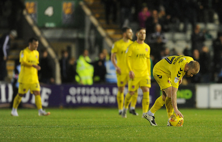 Fleetwood Town's Paddy Madden looks dejected as he places the ball on the centre circle following Plymouth Argyle's first goal, scored by Freddie Ladapo (not in picture)<br /> <br /> Photographer Kevin Barnes/CameraSport<br /> <br /> The EFL Sky Bet League One - Plymouth Argyle v Fleetwood Town - Saturday 24th November 2018 - Home Park - Plymouth<br /> <br /> World Copyright © 2018 CameraSport. All rights reserved. 43 Linden Ave. Countesthorpe. Leicester. England. LE8 5PG - Tel: +44 (0) 116 277 4147 - admin@camerasport.com - www.camerasport.com