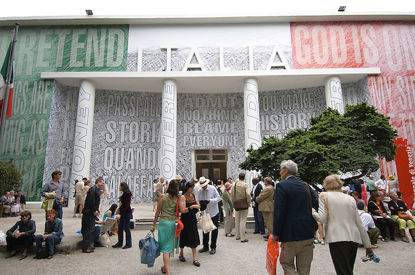 """At the 51st Venice Biennale, visitors walk past the work of American artist Barbara Kruger, who painted a """"wall tattoo"""" on the front facade of the Italian pavillion. The biennale, which brings to Venice, Italy, a wide variety of international contmeporary art every other year, opens June 12 and runs until November 6, 2005. Photos by Kevin J. Miyazaki/Redux"""