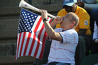 An American fan gets into the spirit of the impending World Cup with his own personalized vuvuzela during the final tune-up match as the U.S. met Australia in a friendly. The U.S. won the match, 3-1, played June 5th, in Ruimsig Stadium,  at Roodepoort, South Africa.