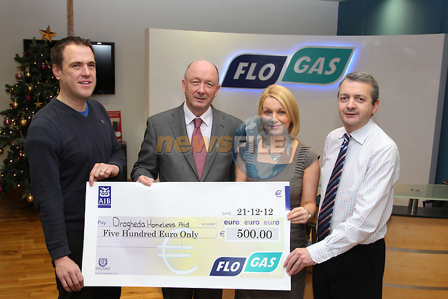 Richard Martin (2Left) and Eoin O'Flynn ® present a cheque for ?500.00 from FLO GAS to Francis Regan and Karen Smith of Drogheda Homeless Aid..Picture: Fran Caffrey/www.newsfile.ie.