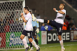 10 September 2008:  Oguchi Onyewu (USA)(5) and Heath Pearce (USA)(15)  continue the ball around after a whistle blows the play dead.  The United States Men's National Team defeated the Trinidad and Tobago Men's National Team 3-0 at Toyota Park in Bridgeview, Illinois in a CONCACAF semifinal round FIFA 2010 South Africa World Cup Qualifier.