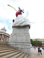 A new artwork by artist Heather Phillipson entitled THE END, was unveiled on the Fourth Plinth in Trafalgar Square. The sculpture tops the Fourth Plinth with a giant swirl of whipped cream, a cherry, a fly and a drone that transmits a live feed of the Square. London on Saturday August 1st 2020<br /> <br /> Photo by Keith Mayhew
