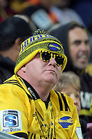 Fans in the grandstand during the Super Rugby match between the Hurricanes and Chiefs at Westpac Stadium in Wellington, New Zealand on Friday, 13 April 2018. Photo: Dave Lintott / lintottphoto.co.nz