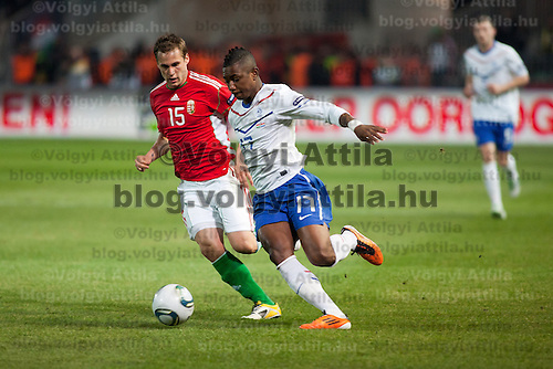 Hungary's Peter Czvitkovics (L) and Nederland's Eljero Elia (R) fights for the ball during a European Championships preliminaray game in Budapest, Hungary on March 25, 2011. ATTILA VOLGYI