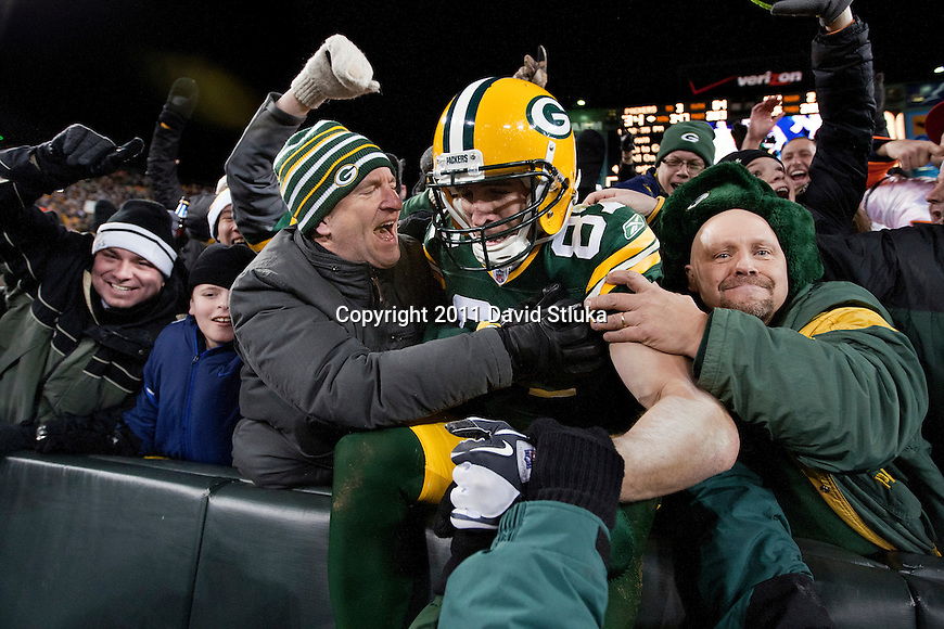 Green Bay Packers wide receiver Jordy Nelson (87) celebrates with a Lambeau Leap into the stands during a week 16 NFL football game against the Chicago Bears on December 25, 2011 in Green Bay, Wisconsin. The Packers won 35-21. (AP Photo/David Stluka)