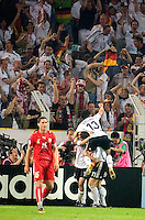 German captain Michael Ballack jumps on his teammates as they celebrate their goal against Poland at FIFA World Cup Stadium, Dortmund, Germany, June 14, 2006.