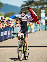 Picture by Alex Broadway/SWpix.com - 07/09/17 - Cycling - UCI 2017 Mountain Bike World Championships - XCO - Cairns, Australia - Laura Stigger of Austria celebrates as she crosses the line to win the Women's Junior World Championship Race.