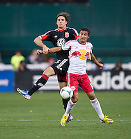 Dejan Jakovic (5) of D.C. United fights for the ball with Tim Cahill (17) of New York Red Bulls during the game at RFK Stadium in Washington, DC.  New York Red Bulls defeated D.C. United, 2-0.