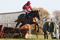 Lucky Vic ridden by C D Timmons in jumping action during the Hempton National Hunt Maiden Hurdle