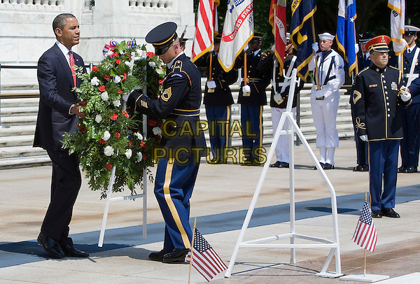 United States President Barack Obama participates in a wreath laying ceremony at the Tomb of the Unknown Soldier in honor of Memorial Day at Arlington National Cemetery in Arlington, Virginia on Monday, May 28, 2012.  .full length black blue suit  .CAP/ADM/KT.©Kristoffer Tripplaar/Pool/CNP/AdMedia/Capital Pictures.