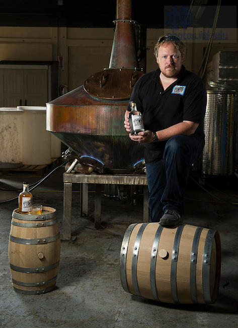 Aug. 26, 2014; Owner Charles Florance MBA '13  with his copper whiskey still at Indiana Whiskey in South Bend. (Photo by Barbara Johnston/University of Notre Dame