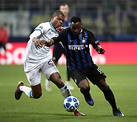 Football: UEFA Champions League -Group Stage - Group B - FC Internazionale Milano vs PSV Eindhoven, Giuseppe Meazza  (San Siro) Stadium, Milan Italy, December 11, 2018.<br /> Inter Milan's Kwadwo Asamoah (r) in action with PSV Eindhoven's Denzel Dumfries (l) during the Uefa Champions League football match between Inter Milan and PSV Eindhoven at Giuseppe Meazza  (San Siro) Stadium in Milan on December 11, 2018. <br /> UPDATE IMAGES PRESS/Isabella Bonotto