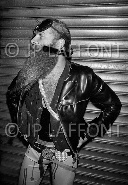 Manhattan, New York City, NY. May, 1980.<br /> A man with a long beard wearing a leather jacket. Times Square had acquired a reputation as a dangerous neighborhood during the 1980's.  The shabiness of the area, especially due its go-go bars, sex shops, and adult theaters, became an infamous symbol of the city's decline.