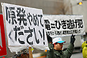 Protesters hold banners during an anti-nuclear rally in front of the headquarters of Tokyo Electric Power Co (TEPCO), the operator of the tsunami-crippled Fukushima Daiichi nuclear plant, on the fifth anniversary of the Great East Japan Earthquake and Tsunami disaster in Tokyo, Japan on March 11, 2016. Almost 19,000 people lost their lives as a result of the magnitude 9.0 earthquake and subsequent tsunami that hit Japan's north east coast 5 years ago. Five years after the event some 174,000 survivors are still in temporary accommodation. This includes nearly 100,000 from Fukushima who have not been able to return home as a result of the effects of the tsunami and nuclear catastrophe that ensued. (Photo by Shingo Ito/AFLO)