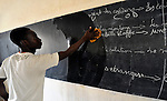 A boy cleans the blackboard during a class in the Bahadon Second Cycle School in Timbuktu, a city in northern Mali which was seized by Islamist fighters in 2012 and then liberated by French and Malian soldiers in early 2013. The jihadis first banned all schools, then under pressure from the community, allowed them to open but with separate classes for boys and girls.