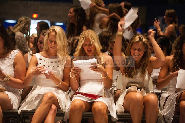 Sorority women receive their bids during UK's sorority bid day in Lexington, Ky., on Friday, August 22, 2014. Photo by Adam Pennavaria | Staff
