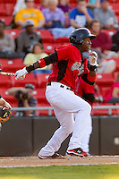 Jurickson Profar #10 of the Hickory Crawdads follows through on his swing against the Augusta GreenJackets at L.P. Frans Stadium on April 29, 2011 in Hickory, North Carolina.   Photo by Brian Westerholt / Four Seam Images