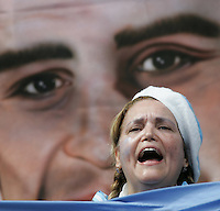 An Argentine fan welcomes her team to the field.  Germany defeated Argentina on penalty kicks after leaving the scored tied in regulation, 1-1,  in their FIFA World Cup quarterfinal match at FIFA World Cup Stadium in Berlin, Germany, June 30, 2006.
