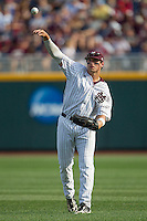 Mississippi State outfielder Hunter Renfro (34) warms up prior to during Game 1 of the 2013 Men's College World Series Finals against the UCLA Bruins on June 24, 2013 at TD Ameritrade Park in Omaha, Nebraska. The Bruins defeated the Bulldogs 3-1, taking a 1-0 lead in the best of 3 series. (Andrew Woolley/Four Seam Images)