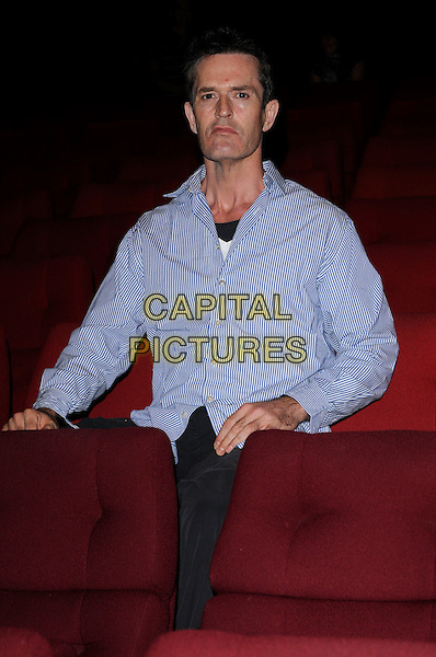 "RUPERT EVERETT.""The Scandalous Adventures of Lord Byron"" screening, BAFTA HQ, Piccadilly, London, England..July 21st, 2009.half length blue shirt striped stripes  sitting chair.CAP/CAN.©Can Nguyen/Capital Pictures."