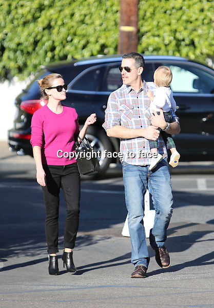 Tennessee Toth &quot;Wild&quot; actress Reese Witherspoon and husband Jim Toth take their son Tennessee to the Brentwood Country Mart in Brentwood, California on November 24, 2013.<br />