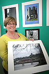 Stella Connor with one of her photos at the Photo Exhibition in the Connect Family Resource Centre, Moneymore...Photo NEWSFILE/Jenny Matthews.(Photo credit should read Jenny Matthews/NEWSFILE)....This Picture has been sent you under the condtions enclosed by:.Newsfile Ltd..The Studio,.Millmount Abbey,.Drogheda,.Co Meath..Ireland..Tel: +353(0)41-9871240.Fax: +353(0)41-9871260.GSM: +353(0)86-2500958.email: pictures@newsfile.ie.www.newsfile.ie.FTP: 193.120.102.198.