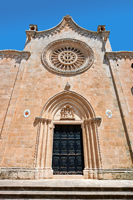 Facade with ogival arched door and rose window of the Italian Gothic Cathedral of Ostuni built between 1569-1495  .Ostuni, The White Town, Puglia, Italy.