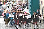 Members of the Valentia Pipe Band leading protesters through Cahersiveen on Friday, the march was to further highlight the plight of patients of Island View Psychiatric Unit which is due to close at the end of the month..