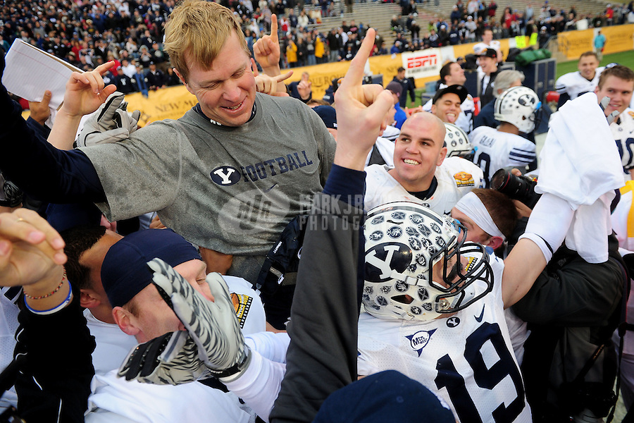 Dec. 18, 2010; Albuquerque, NM, USA; BYU Cougars head coach Bronco Mendenhall is carried on the field by his players following the game against the UTEP Miners in the 2010 New Mexico Bowl at University Stadium. BYU defeated UTEP 52-24. Mandatory Credit: Mark J. Rebilas-