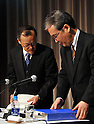 December 7, 2011, Tokyo, Japan - President Shuichi Takayama, left, and his accounting manager Nobuyuki Onishi of the scandal-hit Olympus Corp. leave a news conference in Tokyo on Wednesday, December 07, 2011, a day after an independent panel set up by the Japanese optical equipment company released the results of its investigation into the companys cover-up of investment losses. Takayama hinted at the news conference that the companys top brass may step down at the next shareholders meeting, most likely in February 2012 at the earliest. Former President Michael Woodford is calling for an extraordinary shareholders meeting to discuss the accounting scandal. (Photo by Natsuki Sakai/AFLO) [3615] -mis-