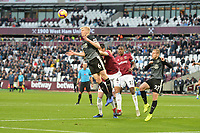 Ben Mee heads clear during West Ham United vs Burnley, Premier League Football at The London Stadium on 3rd November 2018