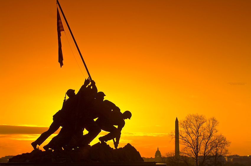 The Iwo Jima Memorial at sunrise (in Arlington, VA.), with the U. S. Capitol and Washington Monument in background, Washington D.C.
