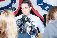 Republican presidential candidate and governor of Wisconsin Scott Walker talks to the media after speaking at a meet and greet with veterans at the Derry VFW in Derry, New Hampshire.