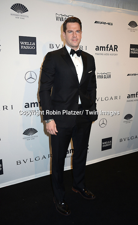 Thomas Roberts  attends the amfAR New York Gala on February 5, 2014 at Cipriani Wall Street in New York City.