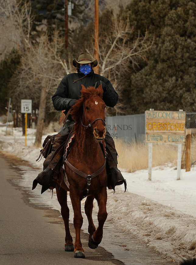 Michael Dyas takes his horse Redd out for a ride down the main street in Crestone, CO, Sunday afternoon. Michael Brands for The New York Times.