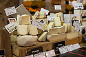 London, UK. 15.11.2014. Varieties of cheese for sale on a stall at Borough Market. Photograph © Jane Hobson.
