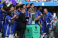After being presented with his Premier League winners medal, John Terry moves in to lift the Trophy during Chelsea vs Sunderland AFC, Premier League Football at Stamford Bridge on 21st May 2017