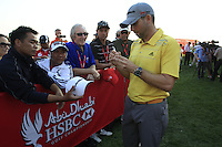 Sergio Garcia (ESP) signs autographs after his match during Thursday's Round 1 of the HSBC Golf Championship at the Abu Dhabi Golf Club, United Arab Emirates, 26th January 2012 (Photo Eoin Clarke/www.golffile.ie)