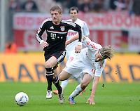 FUSSBALL   1. BUNDESLIGA  SAISON 2011/2012   34. Spieltag 1. FC Koeln - FC Bayern Muenchen        05.05.2012 Toni Kroos (li, FC Bayern Muenchen) gegen Martin Lanig (1. FC Koeln)