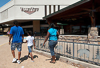 People walk into the entrance to the Valley View Center Mall in Dallas, Texas, Saturday, August 21, 2010. ..MATT NAGER for the Wall Street Journal