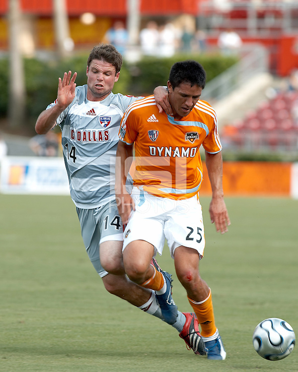 FC Dallas defender Drew Moor (14) attempts to steal the ball from Houston Dynamo forward Brian Ching (25).  Houston Dynamo beat FC Dallas 2-1 at Robertson Stadium in Houston, TX on June 3, 2007.