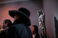 People look at pieces of art at Nayef Homsi's gallery during the Asian Art Week in New York. 11.03.2015. Eduardo MunozAlvarez/VIEWpress.