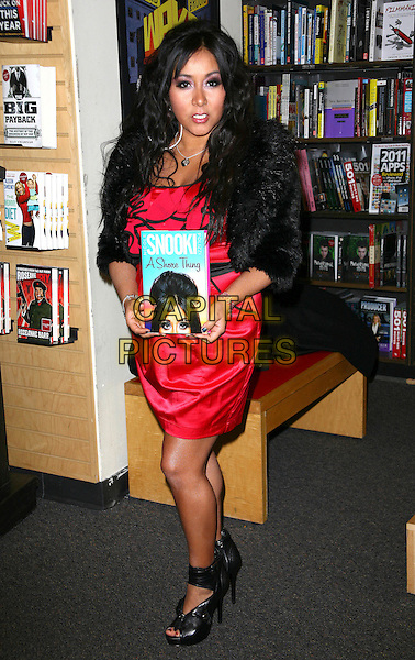"""NICOLE 'SNOOKI' POLIZZI.Nicole """"Snooki"""" Polizzi star of """"Jersey Shore"""" signs copies of her new book """"A Shore Thing"""" at Borders Books and Music at Columbus Circle New York City, New York, NY, USA, .10th January 2011..full length black fur jacket red ruffles dress shoes shooboots ankle boots pep toe platform holding book .CAP/ADM/PZ.©Paul Zimmerman/AdMedia/Capital Pictures."""