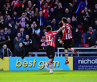 Lincoln City's Tom Pett celebrates scoring his side's second goal with team-mate Bruno Andrade, left<br /> <br /> Photographer Andrew Vaughan/CameraSport<br /> <br /> Emirates FA Cup First Round - Lincoln City v Northampton Town - Saturday 10th November 2018 - Sincil Bank - Lincoln<br />  <br /> World Copyright &copy; 2018 CameraSport. All rights reserved. 43 Linden Ave. Countesthorpe. Leicester. England. LE8 5PG - Tel: +44 (0) 116 277 4147 - admin@camerasport.com - www.camerasport.com