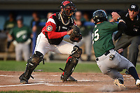 Batavia Muckdogs catcher Luis Alberto Sanz (19) tags out Erik Forgione (25) attempting to score during a game against the Jamestown Jammers on July 25, 2014 at Dwyer Stadium in Batavia, New York.  Batavia defeated Jamestown 7-2.  (Mike Janes/Four Seam Images)