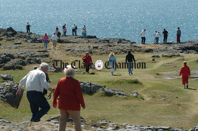 Summer season in full flight.............Tourists take to the rocks in the Burren near Fanore. Photograph by John Kelly.